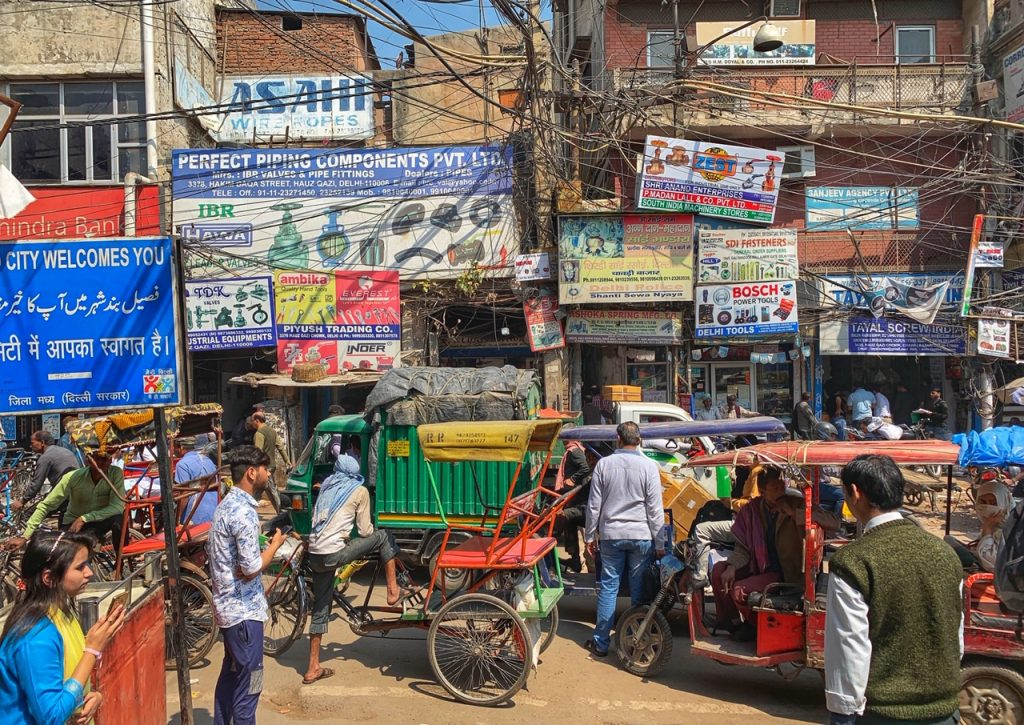 A street scene in Old Delhi, including a mess of overhead wires.