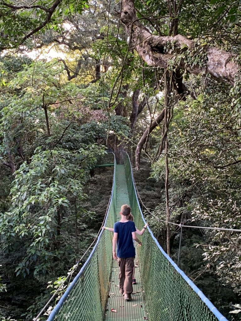 Two children on the hanging bridges at Buena Vista del Rincon