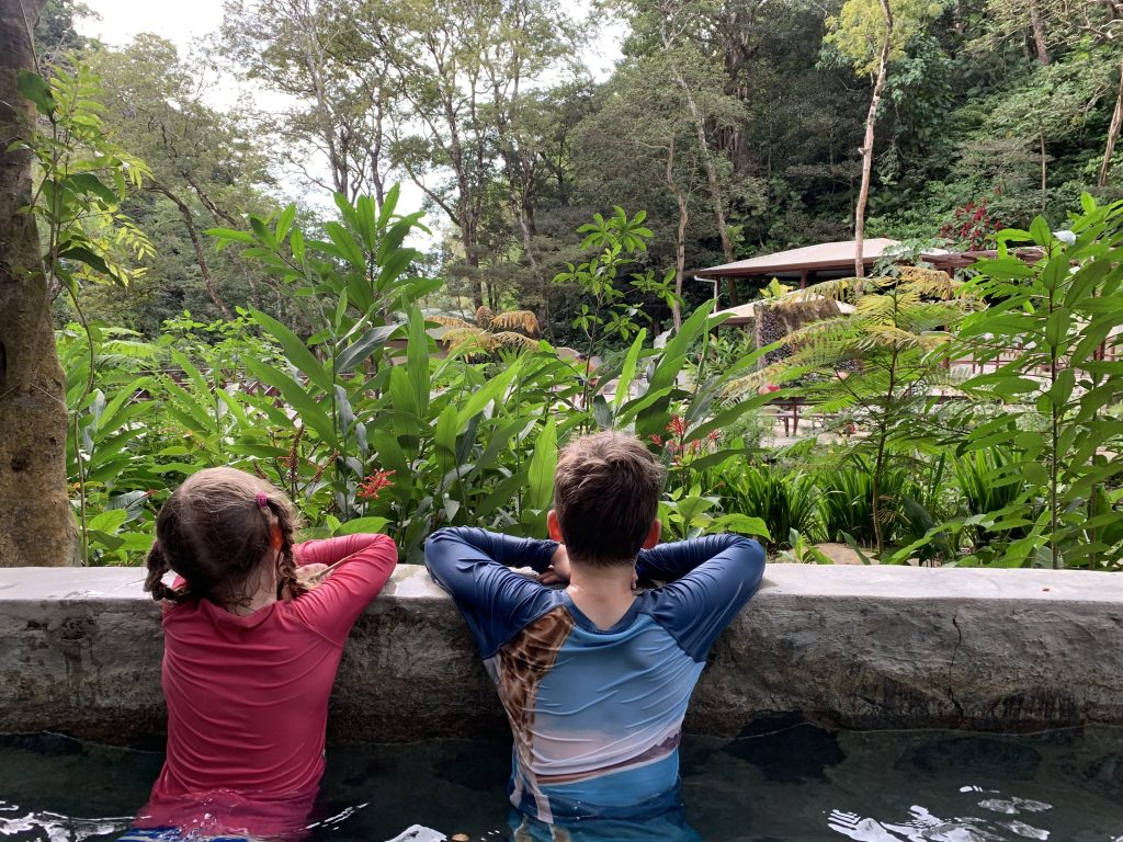 Two kids relaxing in the hotsprings at Buena Vista del Rincon
