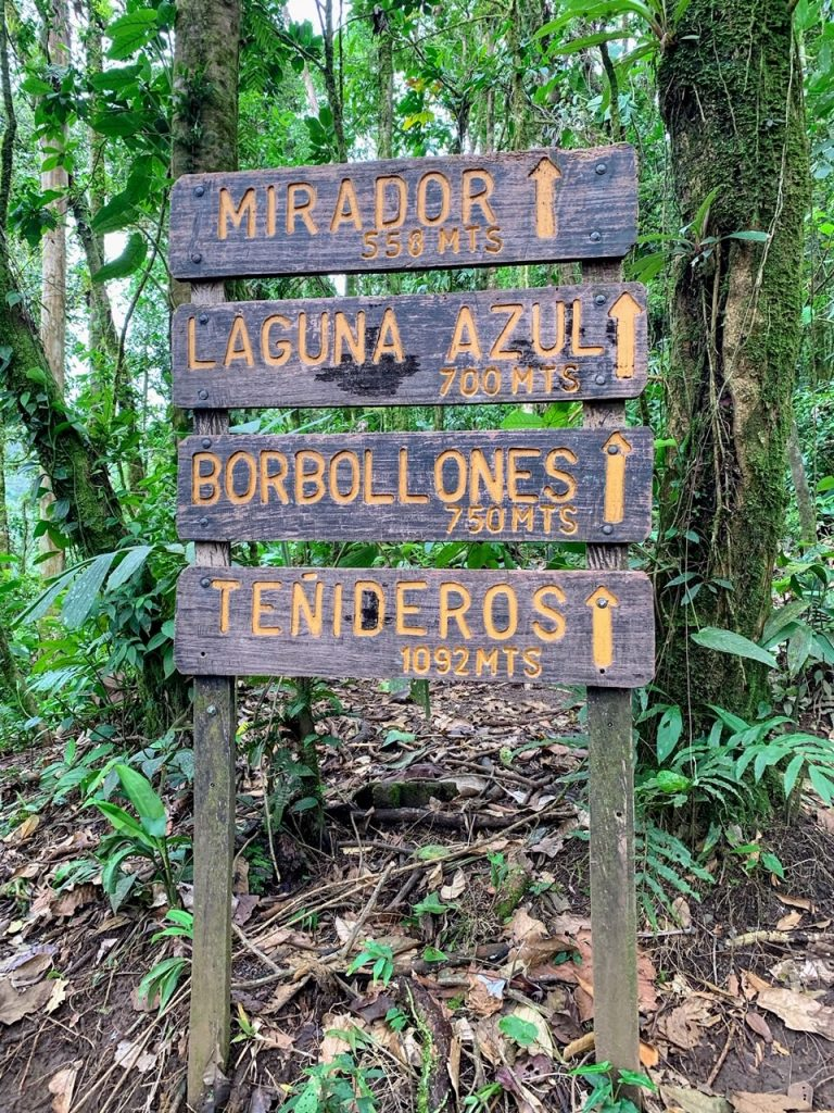 Rio Celeste hiking trail signpost with distances to the main sites