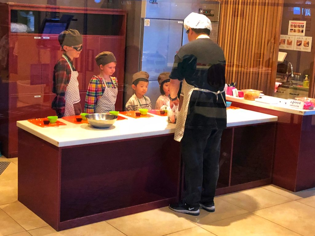 Children learning to be chefs at Kids & Keys - a great place to visit with kids in Seoul, Korea