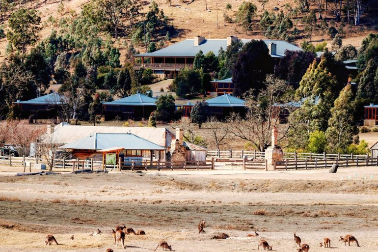 Emirates One&Only Wolgan Valley with kangarros, 1832 Heritage Homestead, and resort buildings.