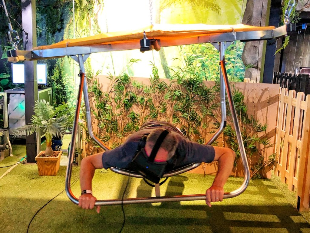 Man in a hang glider at a VR cafe, a top tech attraction in Seoul, South Korea.