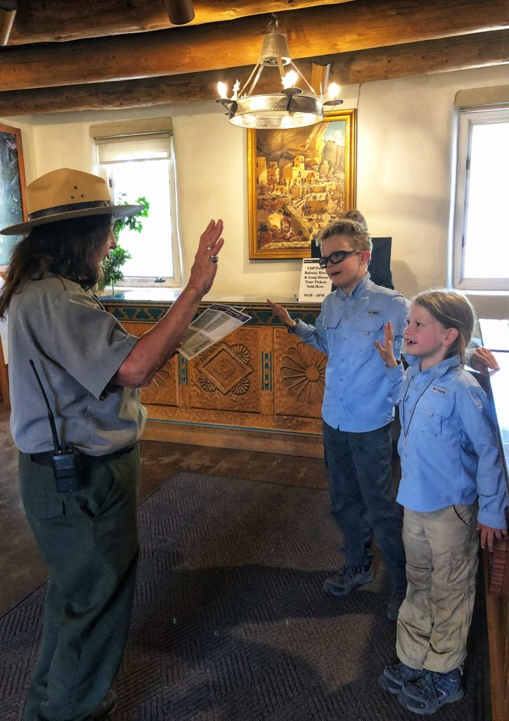 Two children taking the Junior Ranger program oath at Mesa Verde National Parl