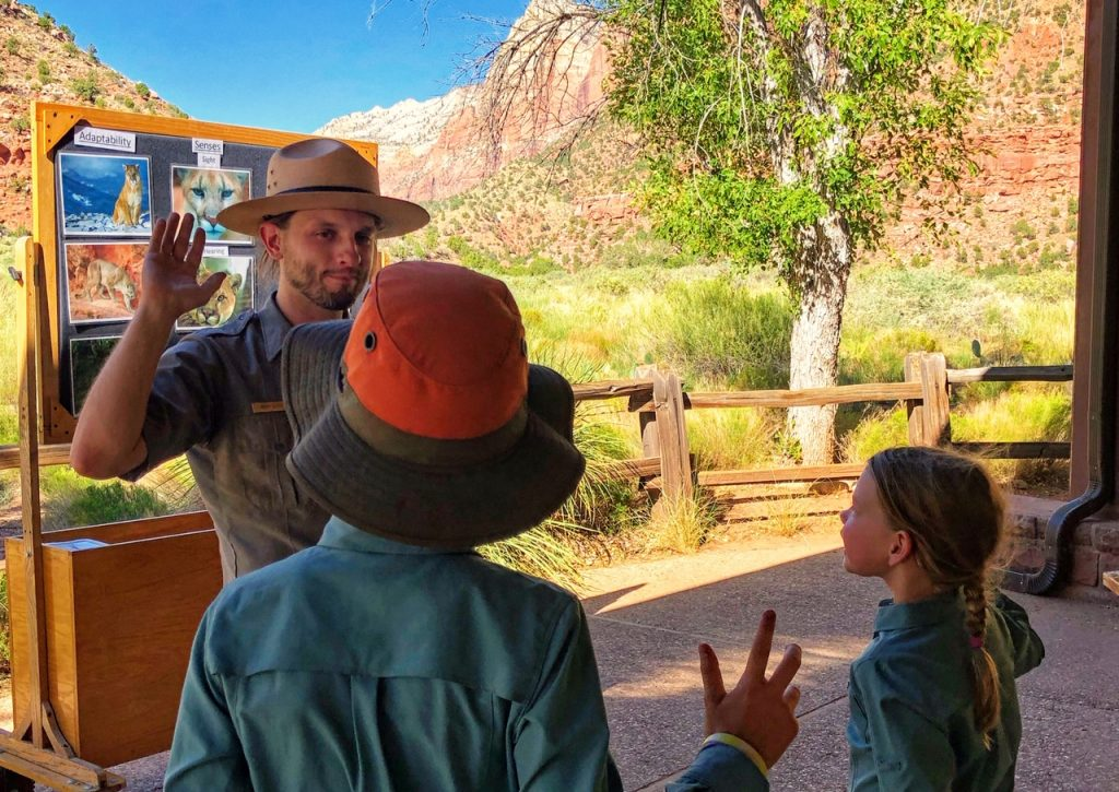 Two children taking the Junior Ranger oath at Zion National Park