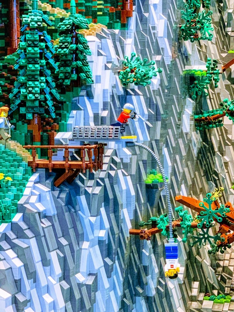 Close-up of a LEGO build featuring a minifigure bungee jumping