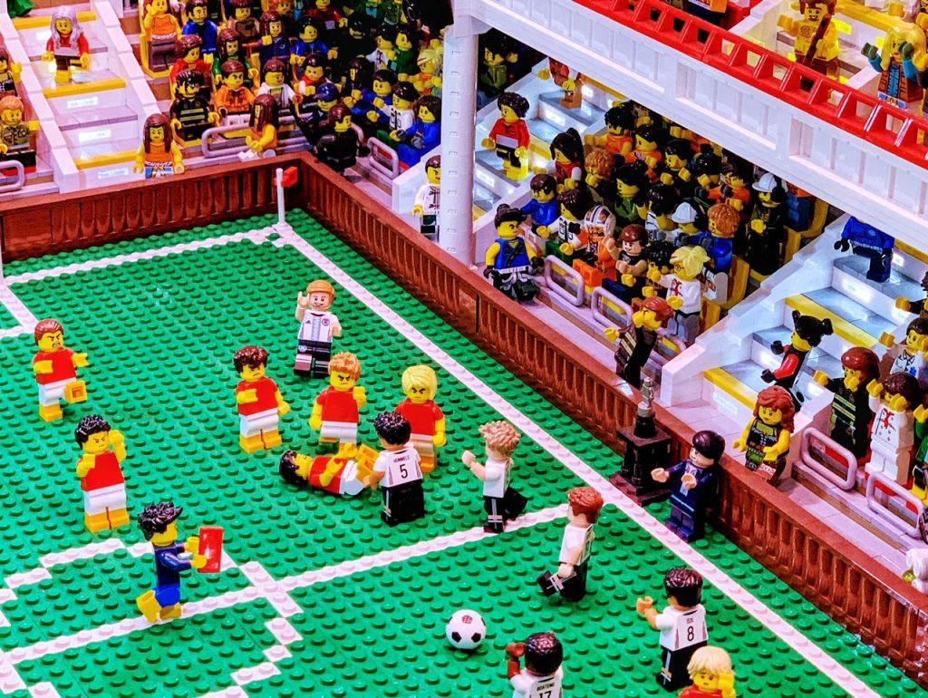 Close-up of a LEGO build featuring a German player being awarded a red card in a game against Denmark. The display is part of LEGO House in Denmark.
