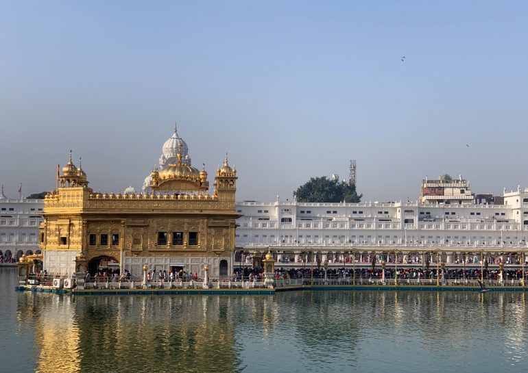The Golden Temple (Sri Harimandir Sahib) sanctum in daylight in Amritsar, India. The Golden Temple is a top thing to do in Amritsar.