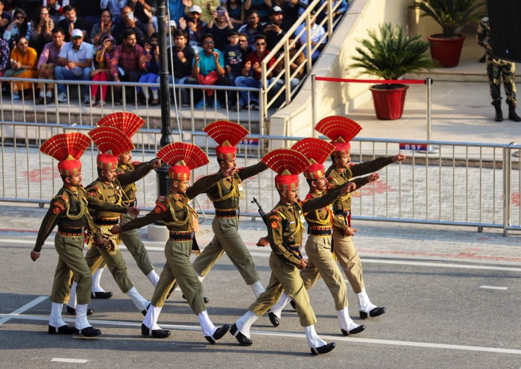 Indian soldiers march towards the Pakistan border at the Wagah Border Closing Ceremony. The Wagah Border is a top thing to do in Amritsar, India.